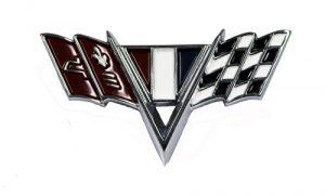 This is an image of a 65-67 Camaro, Chevelle, El Camino & Nova V flag fender emblem