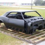 This is an image of a 1967 Camaro Coupe Complete Body Assembly With Top Skin, Drip Rails, Quarter Panels, Doors & Trunk Lid