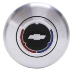 This is an image of a 1967-70 Camaro Wood & Comfort Grip Steering Wheel Horn Cap, GM Licensed